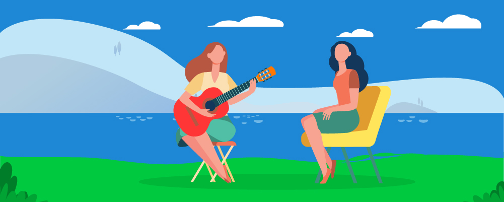 Woman showing her friend that she is learning guitar